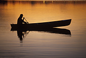 Man Canoeing Sunset in Lake Southcentral AK - Stock Image - A0YE55