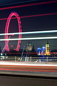 Traffic light trails on Waterloo Bridge with London Eye and Big Ben in the background , London, UK - Stock Image - EKY13W