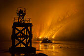 South Queensferry, Edinburgh, UK. 9th Nov, 2014. A search takes place on the Firth of Forth involving Police, Ambulance and RNLI at night in misty conditions.Pictured A boat leaves the pier at South Queensferry. Credit Steven Scott Taylor/Alamy Live News - Stock Image - EA9E7E
