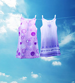 two dresses on a washing line - Stock Image - AB1PPD