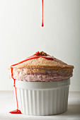 Raspberry Soufflé prepared by Iacopo Falai, Chef/Owner of Falai in New York - Stock Image - BWRMET