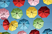 Jerusalem, Israel. 30th June, 2015. An installation of over 1,000 colorful umbrellas spreads over the heads of pedestrians and adorns the historic Yoel Moshe Solomon Street, as the municipality opens the summer season in the downtown area with a multitude of planned street artist performances and local music productions. © Nir Alon/Alamy Live News - Stock Image - EWPT4T