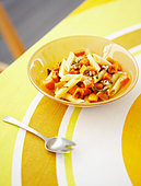 Penne with Sauteed Squash, Nuts and Basil - Stock Image - BJMAR5