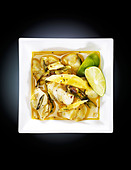Alleppey fish curry, with green chili, red chili, tumeric and coconut cream - Stock Image - BFBFWK