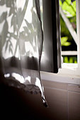 Close-up of open window with curtain - Stock Image - E0892T