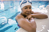 Close up portrait of woman in swimming pool - Stock Image - E025YX