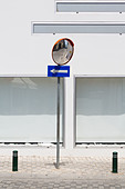 One way sign with mirror on pole, Larnaca, Cyprus - Stock Image - E1MGT6