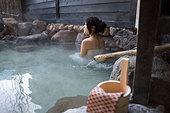 Hot spring Concept Open Air hot spring woman people Beppu Oita Kyushu Japan - Stock Image - B88FHJ