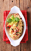Bowl of spaghetti with bacon, onion and egg - Stock Image - BM1R5X