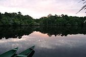 Canoes in Amazon sun rise Brazil - Stock Image - BT2EKF