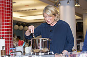 """Chicago, USA. 16th September, 2014.  Martha Stewart, along with Thomas Joseph and Sarah Carey hosted special cooking demonstration as Martha shared secrets from her new collection of recipes and tips for preparing an all-in-one meal using just one pot. Those that attended the event got to sample items she prepared on the spot from her book, """"Martha Stewart Living's One Pot"""" at Macy's State Street store, Chicago, USA. © Linda Matlow/Alamy Live News - Stock Image - E7G2GB"""