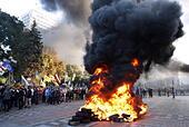 Kiev, Ukraine. 16th Sep, 2014. Ultra-right radicals burn tyres during a rally outside Ukraine's parliamentary building in Kiev. © Maxim Nikitin/ITAR-TASS/Alamy Live News - Stock Image - E7FW1W