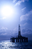On offshore floating oil drilling rig.  Back light view.  Coast of Brazil, 2010. - Stock Image - C85W7R