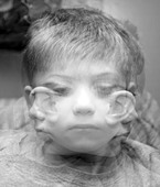 A Triple exposure depicting a small boy looking in three different directions - Stock Image - BEN2EE