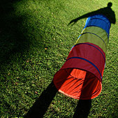 meadow,shadow,toy,tube - Stock Image - CWHCPF
