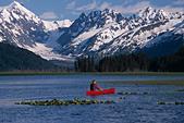 Canoeist on marsh near Placer River w/Kenai Mtns in background Kenai Peninsula Alaska Summer - Stock Image - BA3TY7