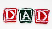 """Knitted woollen lettering spelling """"Dad"""". - Stock Image - ED87CA"""