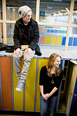 Guy and girl by the lockers - Stock Image - BKW2D4