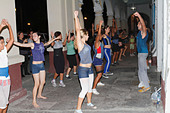 Cuban teenagers, youth, dancing on the street night time. Cienfuegos, Cuba, November 2010 - Stock Image - CWJXCT