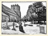 England - Cotswolds - Miserden Church of England exterior view including Graveyard using Monochrome Infrared Effect. Various Gravestones and large tree visible. - Stock Image - S01XET