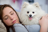 Teenage girl asleep with dog - Stock Image - CBBH8C
