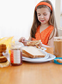 Child making lunch - Stock Image - BEM5H1
