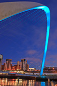 Millennium Bridge and the Baltic Arts Centre Gateshead Newcastle upon Tyne Northumberland England at twilight - Stock Image - C0FD27