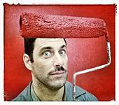 Painter with red paint roller - Stock Image - S04005