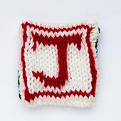 letter J Knitted woollen lettering. - Stock Image - ED87CJ
