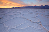 Sunrise over salt polygons and patterns at Badwater Salt Flats in Death Valley National Park, California, USA - Stock Image - CEACNM
