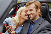 Couple in their electric sports car, fun - Stock Image - BWEE7Y