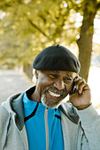 Senior man using a mobile phone, Sweden. - Stock Image - BHH4JA