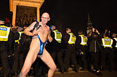 London, United Kingdom. 05th Nov, 2017. Million Mask March 2017 takes place in central London. A protester in a 'mankini' gyrate behind a line of police. Credit: Peter Manning/Alamy Live News - Stock Image - KG9THB