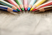 Macro closeup of colorful wooden color pencils on rustic background and selective focus and copy space - back to school concept - Stock Image - DBJA4W