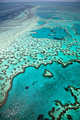 Aerial views of beautiful Heart Reef in the spectacular Great Barrier Reef near the Whitsunday Islands in Queensland, Australia. - Stock Image - CBTET2