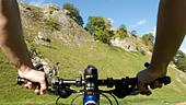 Mountain biking through Cavedale Castleton Peak District National Park Derbyshire England UK GB - Stock Image - B4FHP2