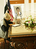 Tribute book signing to Benazir Bhutto, Prime Minister of Pakistan who was assassinated on December 27, 2007, after departing a - Stock Image - C2HJGT