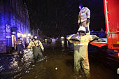 Luebeck, Germany. 04th Jan, 2017. Members of a local fire brigade distribute sandbags in Luebeck, Germany, 04 January 2017. The Federal Maritime and Hydrographic Agency (BSH) forecast storm tides along the German Baltic coast with water levels rising to 1.5 meters above average. Photo: Bodo Marks/dpa/Alamy Live News - Stock Image - HG6EHF