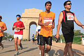 Sep. 30, 2012 - New Delhi, India - Delhi residents participate in the New Delhi Half Marathon as they run by the famous New Delhi landmark, the India Gate.(Credit Image: © Subhash Sharma/ZUMAPRESS.com) - Stock Image - CM48MF