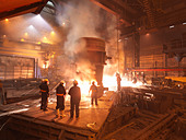 Workers With Molten Steel In Plant - Stock Image - BK942J