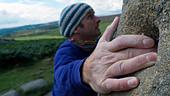 rock climber bouldering at Burbage Edge South, Derbyshire, Peak District National Park, England, UK, United, Kingdom, Great, Bri - Stock Image - DC85AA
