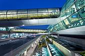 Stylish modern architecture of the 2010 opened Terminal 3 of Dubai International Airport, Dubai, UAE, United Arab Emirates - Stock Image - BKERPG