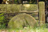 Millstone sign in the Peak District National Park Derbyshire UK England GB Great Britain - Stock Image - B55NGD