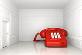 A very big red phone in an empty white room - Stock Image - BP2K4Y