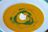 Food, Carrot ginger rosemary soup with sour cream and spinach coulis - Stock Image - AX0KA8