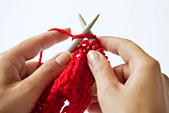 Woman knitting, close-up - Stock Image - C3KCK6