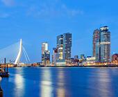 Rotterdam skyline cityscape. Erasmus Bridge and Wilhelmina Pier docklands Cruise Terminal modern buildings the Kop van Zuid. - Stock Image - E6HYB9