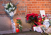 Goring, UK. 26th Dec, 21016.  Flowers, candles and words of sympathy were left outside George Michael's home in Goring. George Michael passed away yesterday.© Pete Lusabia/Alamy Live News - Stock Image - HF0C8J