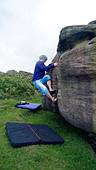 rock climber bouldering at Burbage Edge South, Derbyshire, Peak District National Park, England, UK, United, Kingdom, Great, Bri - Stock Image - DC86R7