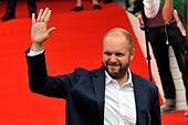 Karlovy Vary, Czech Republic. 9th July, 2015. Czech producer David Ondricek greets fans as he arrived to unveiling of the upcoming film Anthropoid at the 50th International Film Festival in Karlovy Vary, Czech Republic, July 9, 2015. Anthropoid will be filmed in the coming weeks in Czech Republic. © Slavomir Kubes/CTK Photo/Alamy Live News - Stock Image - EX973A